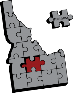 State of Idaho represented by a pieced together jigsaw puzzle, with a missing piece labeled 'business'